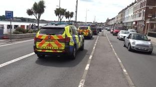 Police were seen searching properties along Weymouth's esplanade.