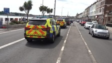 Police were seen searching properties along Weymouth's esplanade.