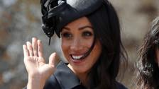 Meghan waves to well-wishers at the wedding.