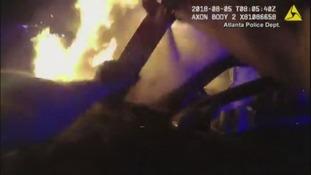 Police in Atlanta save passenger from burning car