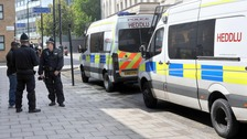 Welsh police officers standing next to van