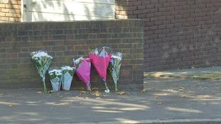Flowers at the scene in Kingston.