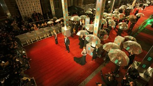 The red carpet outside the Royal Opera House in central London was awash with unbrellas