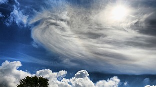 A sun halo, cirrus cloud and cumulus cloud over the Isle of Man