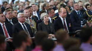 Theresa May sits beside Joachim Gauck and Prince William.
