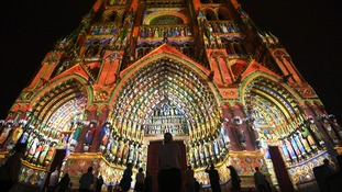 Amiens Cathedral was lit up ahead of the ceremony.