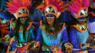Revellers of Portela samba school dance at the festival.