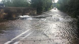 A water main burst on Alfreton Road, flooding the street