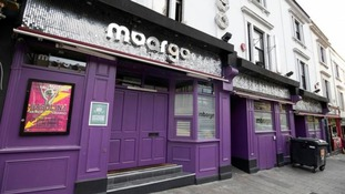 The three men fought outside of Mbargo nightclub.