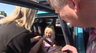 Children 'safer if they face backwards in car seats'