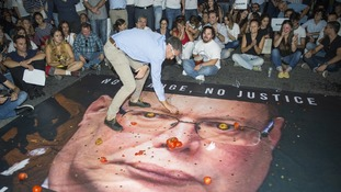 A banner with the photo of the Malta police commissioner Lawrence Cutajar after a rally to honour Daphne Caruana Galizia.