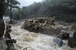 Water gushes out following heavy rain in Kozhikode, Kerala state, India