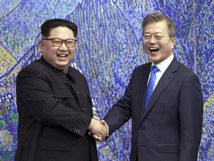North Korean leader Kim Jong Un, left, with South Korean President Moon Jae-in