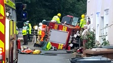 Three injured after fire engine overturns on Essex/Suffolk border