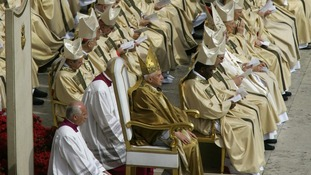 Pope Benedict XVI sits with cardinals during his inaugural mass in St. Peter's Square in the Vatican April 24, 2005.