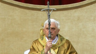 German Pope Benedict XVI holds his pastoral staff as he arrives to lead his first public mass in 2005.