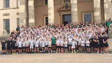 Young rugby players get coaching from Northampton Saints players