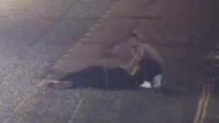 Ryan Hale taking off his shirt to cushion the head of Ryan Ali