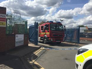 Firefighters leaving the prison car park on Tuesday, following the arson attack