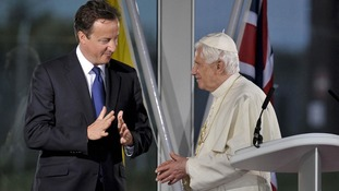 Prime Minister David Cameron and Pope Benedict XVI chat after speeches at a departure ceremony at Birmingham International Airport in 2010.