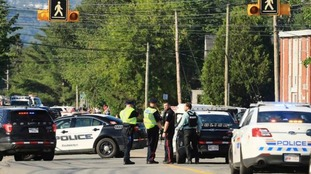 Two police officers were among the four dead