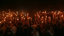 White supremacists held a candlelit far right rally in Charlottesville last year.