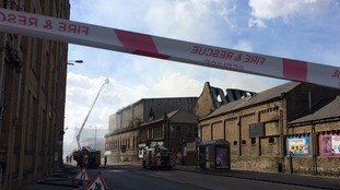 The fire has affected  travel in the area with trains cancelled and roads closed.