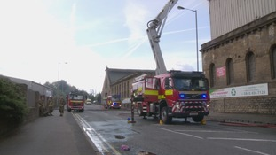 Firefighters acted quickly to remove a number of dangerous gas canisters that were inside.