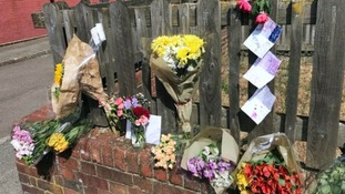 Tributes were left on a fence near to the home on Adolphus Street.