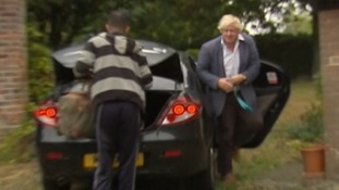 Boris Johnson greets the media armed with a tray of mugs as he makes his first public comments in the burka row