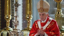 Pope Benedict XVI prays during a mass in London in 2010