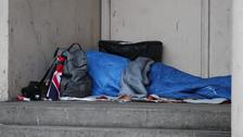 A homeless person sleeping rough in a doorway in Farringdon, London
