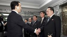 South Korean Unification Minister Cho Myoung-gyon, left, shakes hands with his North Korean counterpart Ri Son Gwon