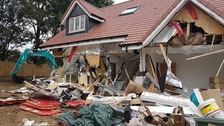 Builder accused of smashing down houses in row over pay