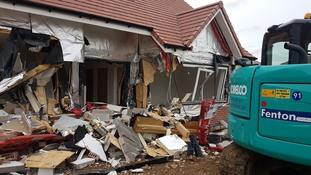 Builder appears in court charged over damage to new houses