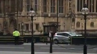 The car which crashed into the security barriers.