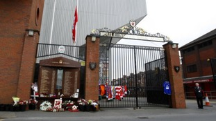 Tributes outside the gates next to the Hillsborough Memorial at Anfield.