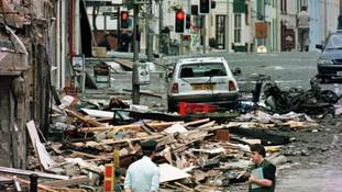 A police officer looks at the damage.