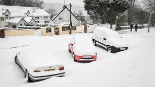 Snow on cars in Merthyr Tydfil