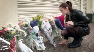 Flowers are left at the scene the day after the bombing.