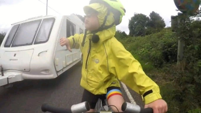 child cyclist gives thumbs down to near miss driver