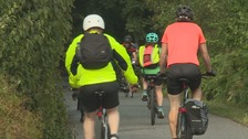 Cyclists wearing neon clothing