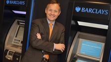 Barclays Chief Executive Antony Jenkins stood by ATMs.