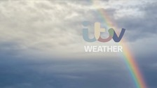 Rather cloudy with occasional rain, clearing early afternoon to sunny periods