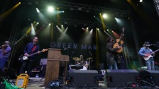 Band performing on stage at Green Man