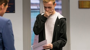 A student with his exam results