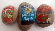 Teacher decorates rocks with miniature versions of book covers