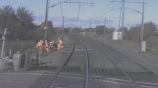 Three railway workers had just three seconds to get out of the way of a high speed passenger train.