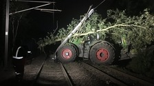 A large uprooted tree could be seen on top of the tractor.