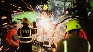 Firefighters worked through the night to remove the tractor.